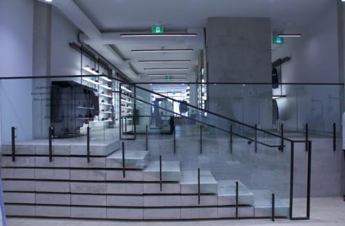 Chaneled glass railings between brackets