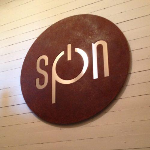 Rusted laser cut logo sign