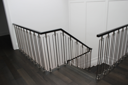 Stainless steel railings between hickory hand rail