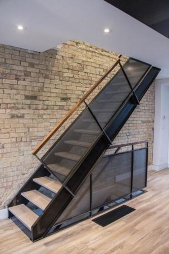 Steel stair . mesh railings in clear finish , oak treads