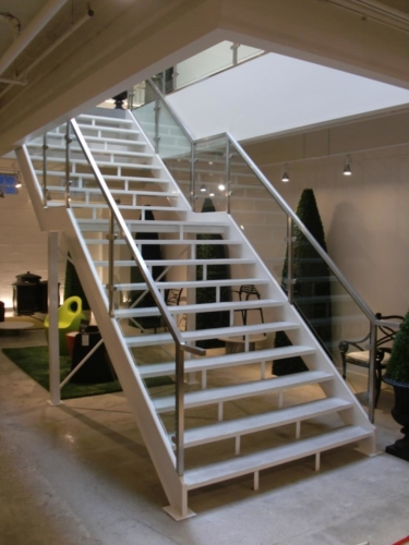 Two level, wide stair betweenconcrete treads including railings